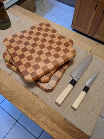 Checkered cherry and maple cutting board