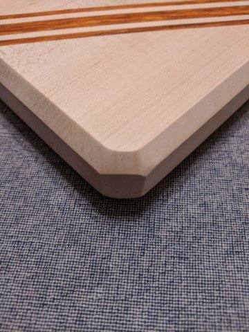 Maple and Paduak stribed cutting board